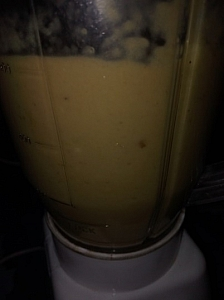 Using a blender to blend the fruits nto a smooth consistency