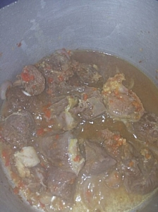 A well seasoned beef in a cooking process