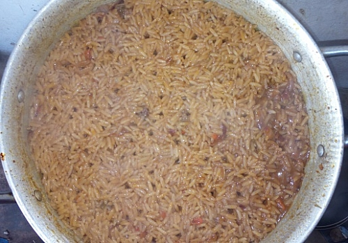 The rice is partially dried, it is almost time to add the vegetables.