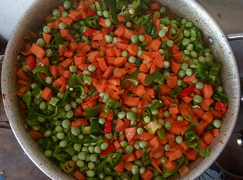 Vegetables are added into the jollof rice