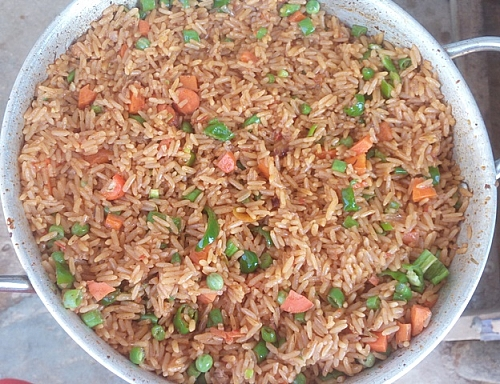 Do not take the jollof rice off from heat immediately after stirring in vegetable, allow it to sit on a low heat for at leat 3 minutes to get hot and for more flavour to diffuse.