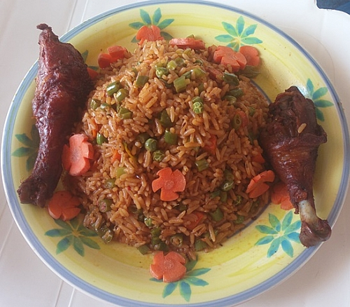 Party jollof rice is served with fried chicken