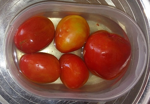 In blanching the tomatoes, you will be able to peel the skin off easily