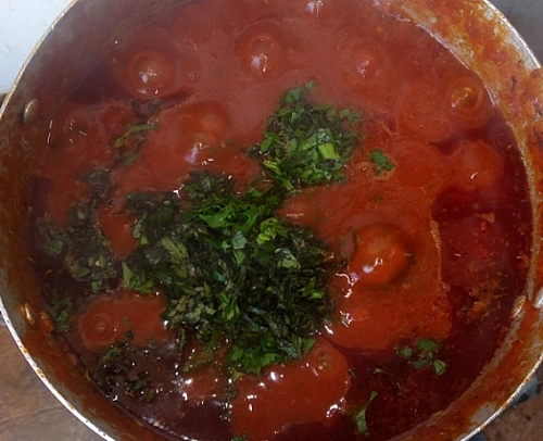 After adding the leaves, stir the sauce and adjust seasonings if there is need for that.