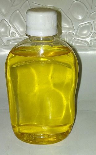 Processed coconut oil in a bottle