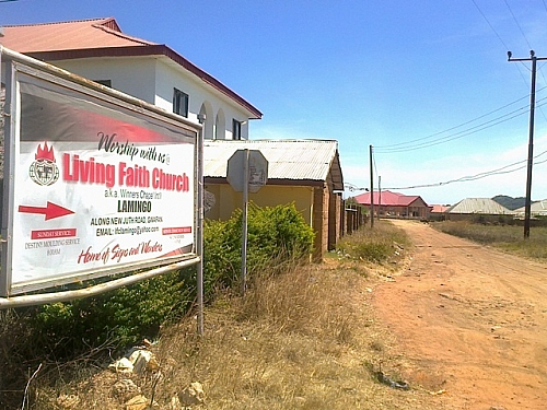 Living Faith Church Sign post by White House, Lamingo