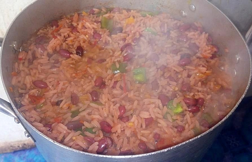 If the liquid dries while the rice is not yet cooked, you can add more water to it to enable it cook properly
