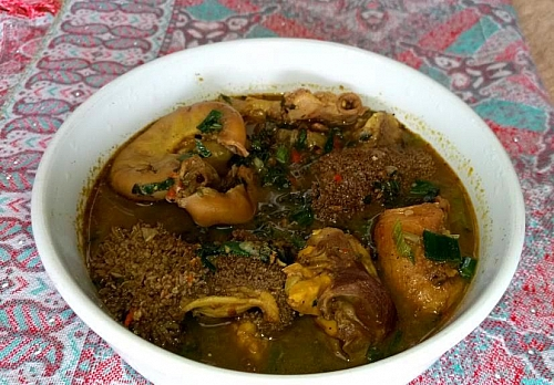 A plate of assorted meat pepper soup