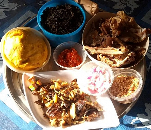 Different ingredients for cooking bitter leaf soup with cocoyam