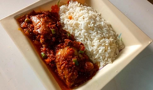 Serving of Chicken stew with boiled rice