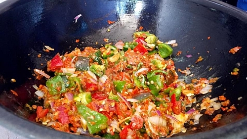 After you have seasoned the pepper with spices, you can now add the chopped bell peppers to the sauce and fry for few minutes