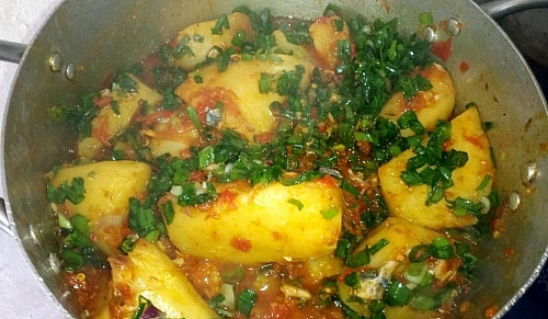 Oce you have stirred the porridge properly, add the shredded fish and the vegetable and stir also
