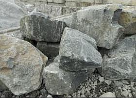 Black basalt rock, an example of extrusive igneous rock