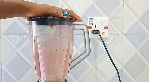 Making of strawberry milkshake in a blender