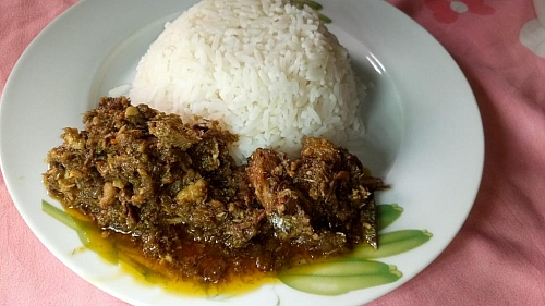 Ayamase stew served with white boiled rice