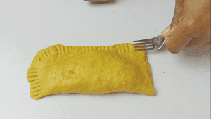 Use a fork to press the edges to stick together