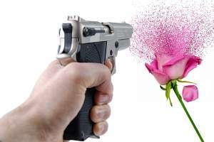 Gun/Firearm Violence Depicted As Handgun Blasting A Beautiful Flower.