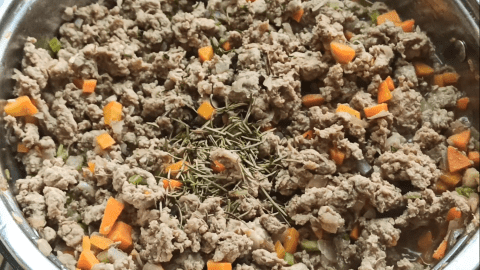 Add herbs to the lamb filling