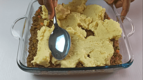 Spread the mashed potatoes in an even layer like you did to the lamb filling