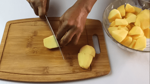 Cut your potatoes into smaller chunks for making the shepherd's pie