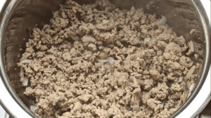Cook the ground beef until it is no longer pink in color