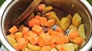 Add the potatoes and carrots