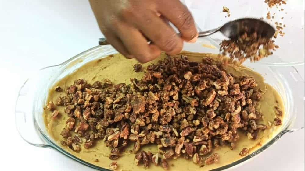 Pour the pecan topping over the mashed sweet potato filling
