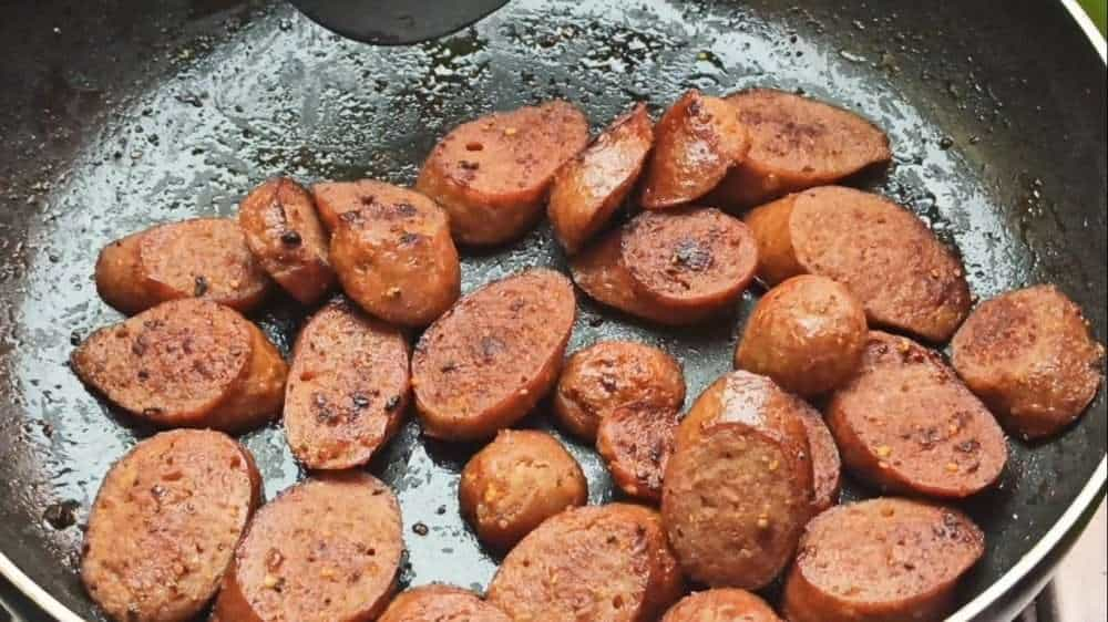 Fry the sausages on both sides until they are brown in color